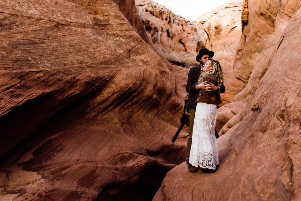 couple-embracing-during-slot-canyon-elopement-page-arizona-how-to-tell-your-family-and-friends-that-you-are-eloping-intimate-wedding-and-adventure-elopement-photographer