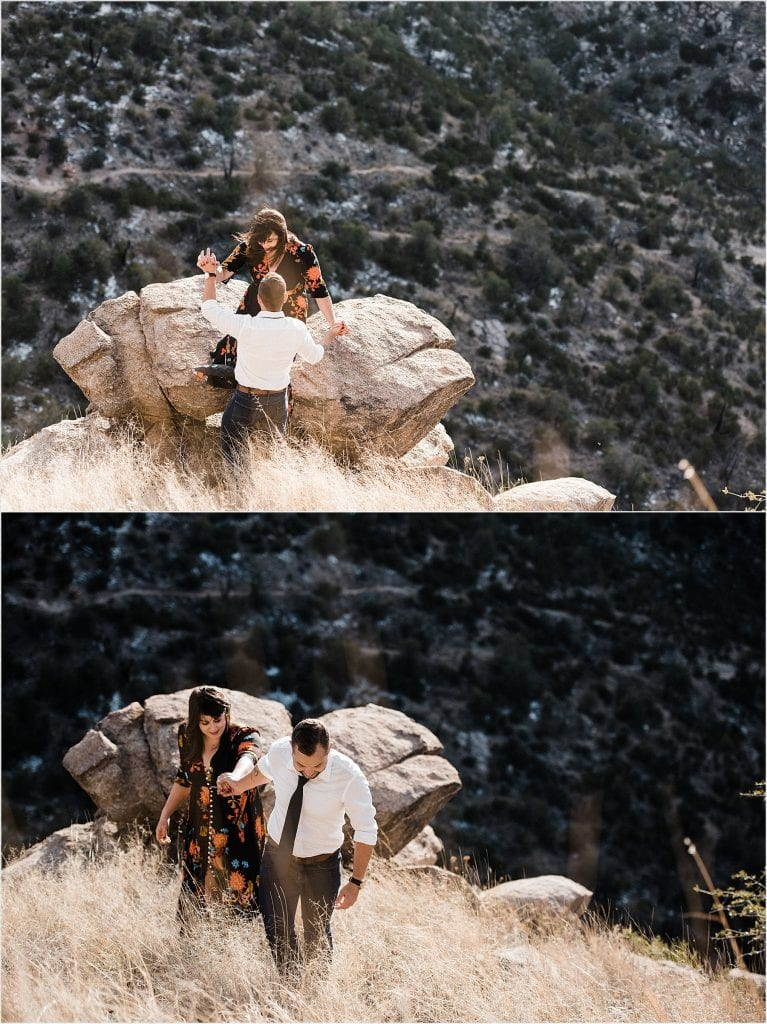 guy-leading-girl-through-golden-grass-at-epic-mount-lemmon-overlook-adventurous-engagement-session-in-the-santa-catalina-mountains-tucson-arizona